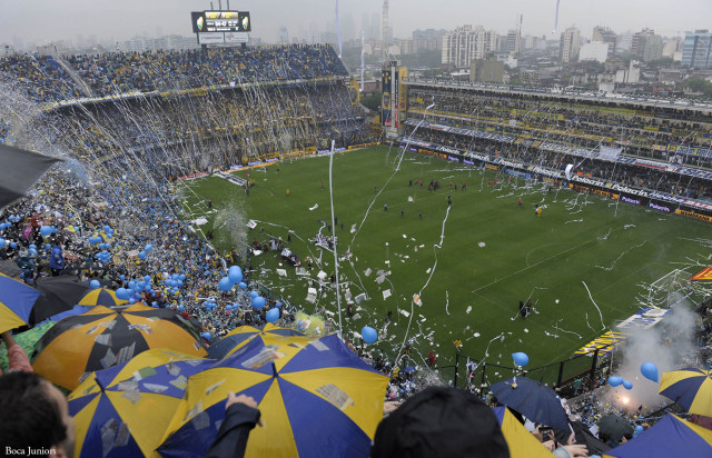 Boca Juniors' supporters cheer their team before  the start of Argent